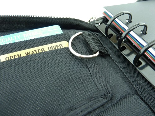 There are two certification card holder pockets and a key ring